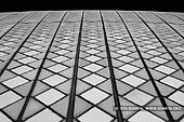 australia stock photography | Roof Tiles of Sydney Opera House, Sydney, NSW, Australia, Image ID AU-SYDNEY-OPERA-HOUSE-0019. Black and white close-up photo of the tiles of the beautiful and iconic Sydney Opera House in Sydney, NSW, Australia. These tiles were made in Sweden and one employee stayed in Denmark to sort the tiles that were sent to Sydney. Over 1 million of glossy tiles and matte tiles on the Opera House shells are set in a diagonal pattern rather than a straight checkerboard pattern.