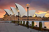 australia stock photography | Sydney Opera House at Sunrise, Sydney, NSW, Australia, Image ID AU-SYDNEY-OPERA-HOUSE-0034. Stock image of the Opera House in Sydney, NSW, Australia at sunrise right before the street lights were switched off.