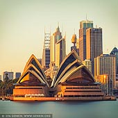 australia stock photography | Sydney Opera House at Sunrise, Kirribilli, Sydney, New South Wales (NSW), Australia, Image ID AU-SYDNEY-OPERA-HOUSE-0038. A shot from Kirribilli on the North Shore looking across harbour to Sydney Opera House. The glow of the sunrise meets the stone of the opera house giving it a beautiful glow.