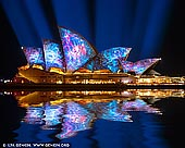 australia stock photography | Vivid Sydney 2014 - Lighting of the Sails, Sydney, NSW, Australia, Image ID VIVID-SYDNEY-2014-0001. This year, Vivid LIVE has commissioned award-winning international artists 59 Productions to create a new projected artwork for the sails of the Sydney Opera House, Vivid LIVE's most public event. Lauded for developing 'the most sophisticated use of film in the theatre to date' (Metro) and creating 'an entirely new art form' (The Guardian), 59 Productions will now take the iconic building on a dramatic journey through time - from the birth of architecture and civilization through to the pinnacle of human and technological achievement.