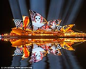 australia stock photography | Lighting The Sails 'Songlines' - Vivid Sydney 2016, Sydney, NSW, Australia, Image ID VIVID-SYDNEY-2016-0001. Lighting the Sails for the eighth year of Vivid Sydney, Sydney Opera House will transform into an animated canvas of Australian indigenous art featuring iconic contemporary works from Karla Dickens, Djon Mundine, Gabriella Possum Nungurrayi, Reko Rennie, Donny Woolagoodja, and the late Gulumbu Yunupingu. Celebrating First Nations' spirituality and culture through the songlines of our land and sky, this year's Lighting the Sails is about painting and celebrating country through a pattern of sharing systems, interconnected history lines and trade routes. Lighting the Sails Director and Head of Indigenous Programming at Sydney Opera House Rhoda Roberts has selected six artists of different clans, national estates and territories for an immersive projected artwork that weaves through time and distance. As the first indigenous work commissioned exclusively for the sails of the Sydney Opera House, this visual tapestry will weave through personal journeys, while celebrating the timeless themes and enduring art of Australia's most influential contemporary First Nations artists, exclusive to Vivid Sydney.