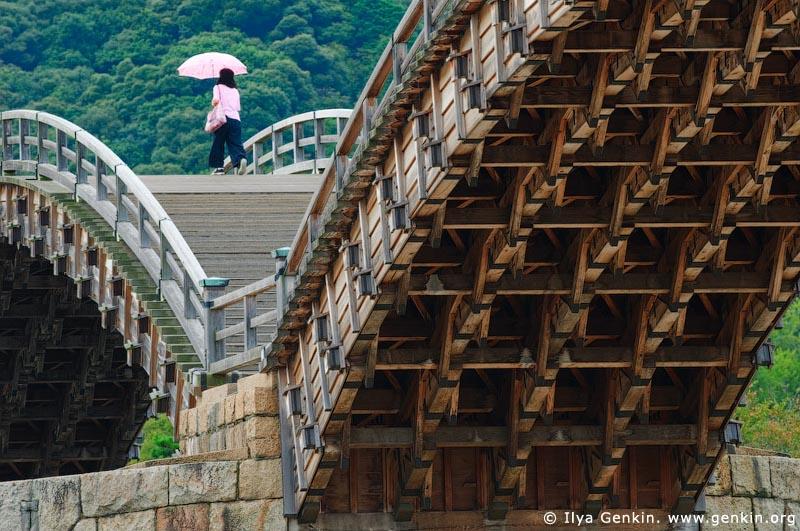 japan stock photography | Woman Crossing Kintai-kyo (Kintai Bridge), Iwakuni, Honshu, Japan, Image ID JPIW0006