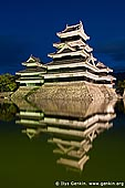 japan stock photography | Matsumoto Castle at Night Reflected in Moat, Matsumoto, Nagano Prefecture, Chubu region, Honshu Island, Japan, Image ID JP-MATSUMOTO-0005. At night Matsumoto Castle in Matsumoto, Japan is highlighted by powerful electric lamps so even at night tourists can enjoy the beauty of one of three black castles in Japan.