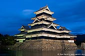 japan stock photography | Matsumoto Castle at Night, Matsumoto, Nagano Prefecture, Chubu region, Honshu Island, Japan, Image ID JP-MATSUMOTO-0007. Black Matsumoto Castle (Matsumoto-jo) in Matsumoto, Japan highlighted at night.