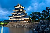 japan stock photography | Black Matsumoto 'Crown' Castle at Dusk, Matsumoto, Nagano Prefecture, Chubu region, Honshu Island, Japan, Image ID JP-MATSUMOTO-0008. Night is approaching at Matsumoto Castle (Crown Castle) in Matsumoto, Japan after a very stormy day. Heavy clouds covered the sky before sunset.