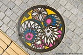 japan stock photography | Painted Manhole Cover in Matsumoto, Matsumoto, Nagano Prefecture, Chubu region, Honshu Island, Japan, Image ID JP-MATSUMOTO-0010. Artistically painted manhole covers in Matsumoto, Japan. Matsumoto Temari Handballs painted on sewer manhole covers in the city of Matsumoto in Nagano Prefecture, Chubu region, Honshu island of Japan. Temari Handballs are Matsumoto's most well-known folk craft - colorful
