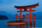 japan stock photography | A Boat Going Through O-Torii (Grand Gate), Itsukushima Shrine, Miyajima, Honshu, Japan, Image ID JPMI0003.