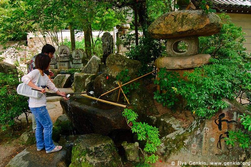 japan stock photography | Visitors Cleanse Their Hands at a Purification Fountain, Daisho-in Temple, Miyajima, Honshu, Japan, Image ID JPMI0061