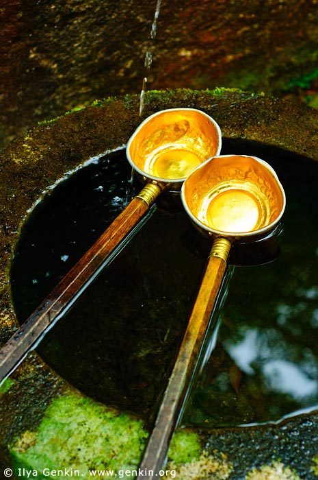 japan stock photography | Golden Ladles at a Purification Fountain, Daisho-in Temple, Miyajima, Honshu, Japan, Image ID JPMI0088