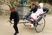 japan stock photography | Wedding Couple in Rickshaw, Miyajima, Honshu, Japan, Image ID JPPE0002.