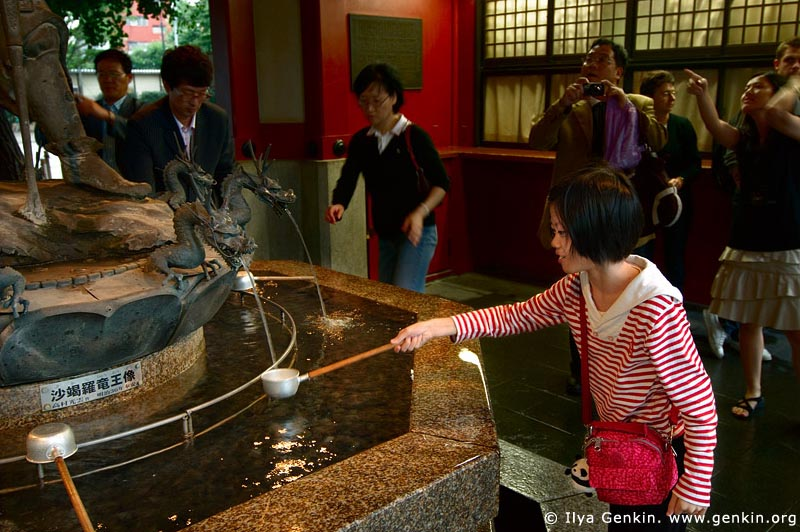 japan stock photography | Girl Cleanse Her Hands at a Tsukubai (Purification Wash Basin), Senso-ji Temple, Asakusa, Tokyo, Kanto Region, Honshu Island, Japan, Image ID JP-TOKYO-0007