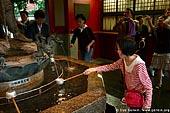 japan stock photography | Girl Cleanse Her Hands at a Tsukubai (Purification Wash Basin), Senso-ji Temple, Asakusa, Tokyo, Kanto Region, Honshu Island, Japan, Image ID JP-TOKYO-0007.