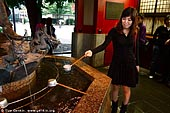 japan stock photography | Woman Cleanse Her Hands at a Tsukubai (Purification Wash Basin), Senso-ji Temple, Asakusa, Tokyo, Kanto Region, Honshu Island, Japan, Image ID JP-TOKYO-0008.