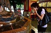 japan stock photography | Woman Cleanse Her Hands at a Tsukubai (Purification Wash Basin), Senso-ji Temple, Asakusa, Tokyo, Kanto Region, Honshu Island, Japan, Image ID JP-TOKYO-0009.
