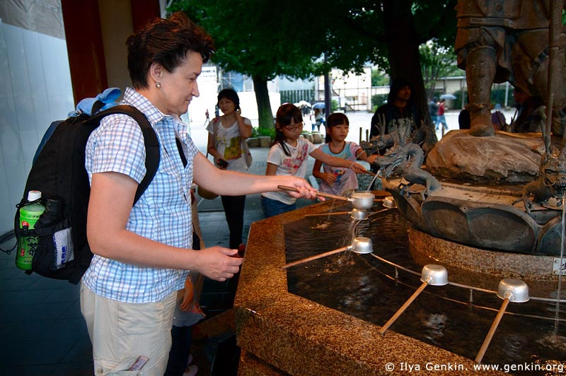 japan stock photography | Woman Cleanse Her Hands at a Tsukubai (Purification Wash Basin), Senso-ji Temple, Asakusa, Tokyo, Kanto Region, Honshu Island, Japan, Image ID JP-TOKYO-0011