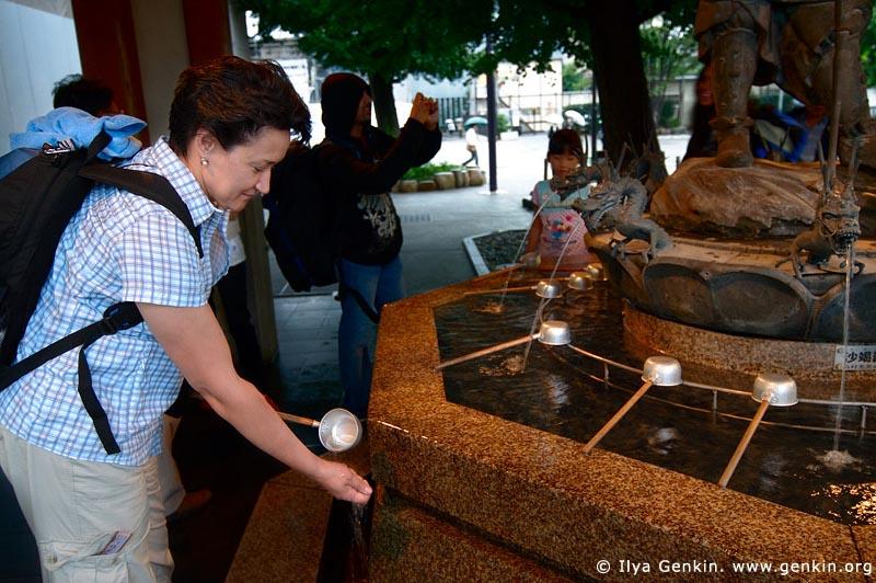 japan stock photography | Woman Cleanse Her Hands at a Tsukubai (Purification Wash Basin), Senso-ji Temple, Asakusa, Tokyo, Kanto Region, Honshu Island, Japan, Image ID JP-TOKYO-0012