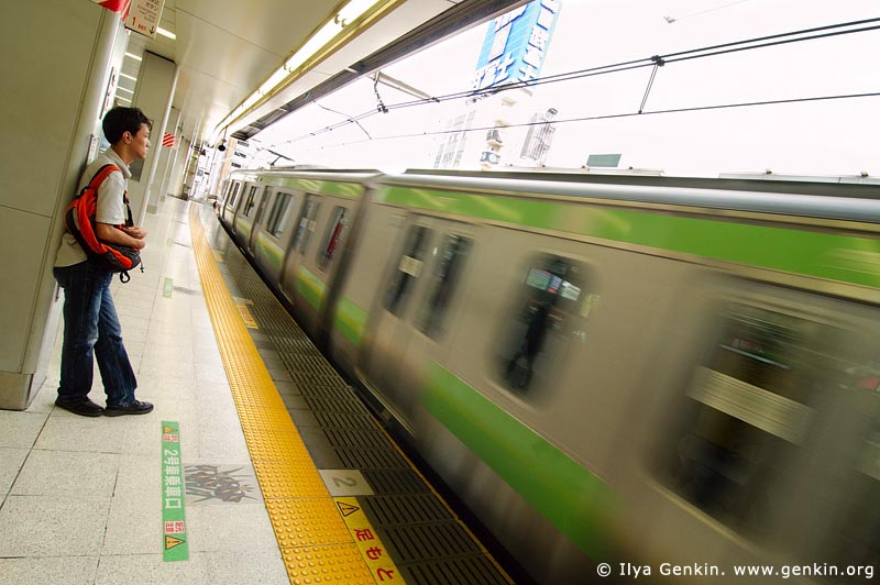 japan stock photography | Man is Looking at a Train Passing a Platform, Tokyo Subway Train, Tokyo, Kanto Region, Honshu Island, Japan, Image ID JP-TRANS-0005