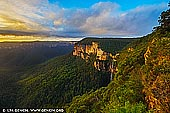 landscapes stock photography | Bridal Veil Falls at Sunrise, Govett's Leap Lookout, Blackheath, Blue Mountains National Park, NSW, Australia, Image ID AU-GOVETTS-LEAP-0004. The Govett's Leap Lookout has glorious panoramic views across the Grose Valley and to the right Govetts Leap Brook ends in the Bridal Veil Falls (Govetts Leap Falls) - the highest falls in the Blue Mountains at 180m. Govetts Leap was named after William Govett, one of the first surveyors of the upper Blue Mountains, in 1831. A horse and rider monument in the park beside the Great Western Highway at Blackheath village tells the story about Govetts Leap. There is a dramatic legend that tells of an escaped convict - turned bushranger named Govett who, pursued by troopers, found himself trapped on the edge of a 300 metre cliff. Preferring death to capture, he wheeled his horse around and together they leapt over the edge. To dispel the legend, Govetts Leap wasn't named because he jumped off the cliff at this point. The Scots Dialect Dictionary compiled by Alexander Warrack MA describes a 'leap' as a 'small cataract' - a cataract is a waterfall. Therefore Govetts Leap actually refers not to the lookout, but to the falls in Govetts Leap Brook, often known as Bridal Veil Falls.