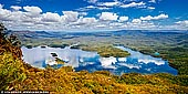 landscapes stock photography | Lake Burragorang, Blue Mountains, NSW, Australia, Image ID AU-LAKE-BURRAGORANG-0001. Panoramic view over Lake Burragorang in the lower Blue Mountains of New South Wales, Australia. McMahons Lookout offers splendid, unspoilt views across the backwaters Lake Burragorang, Sydney's man-made water supply dammed reservoir which supplies 80% of Sydney's precious water supply. This is a rare look at a different side of the Blue Mountains. Far to the south are the region's sandstone cliffs but in the foreground, smudged with the distinctive blueness of the mountains, are low-lying, rolling hills covered with eucalypts. And below is the drowned river valley with the occasional hilltop, still covered with trees, rising from the waters.