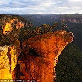 landscapes stock photography | Hanging Rock at Sunrise, Baltzer Lookout, Blackheath, Blue Mountains, NSW, Australia, Image ID HANGING-ROCK-BLUE-MOUNTAINS-0006. The walk to Baltzer Lookout rewards you with excellent scenery and a view over the stunning Hanging Rock (aka the Finger). A huge, overhanging block of sandstone over 100m high, jutting out into the Grose Valley, has become detached from the main cliff. It has featured in many calendars and climbing photos, and was also the site of the main climbing scene in 'The Edge' movie.