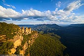 landscapes stock photography | The Three Sisters at Sunset, Echo Point, Katoomba, Blue Mountains, NSW, Australia, Image ID THREE-SISTERS-BLUE-MOUNTAINS-0003. The Three Sisters is the Blue Mountains' most spectacular landmark and a famous rock formation and is located at Echo Point, Katoomba, NSW, Australia. Offering panoramic views into the Jamison Valley, these three prominent rocky pinnacles on the edge of the escarpment at Echo Point have become an iconic symbol for the Blue Mountains. The Three Sisters can be viewed from the main lookout or the Queen Elizabeth or Prince of Wales Lookouts on the lower levels. A walk from behind the Visitor Information Centre will lead you to the top of the Three Sisters via Honeymoon Bridge from the Giant Stairway.