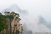 landscapes stock photography | View from Beginning to Believe Lookout, Beihai (North Sea) Scenic Area, Huangshan (Yellow Mountains), China, Image ID CHINA-HUANGSHAN-0010. From the Beginning-to-believe lookout tourists may enjoy the beautiful scenery of the Beginning-to-believe Peak (Shixin Peak) and Beihai (North Sea) Scenic Area.