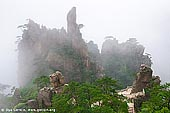 landscapes stock photography | Xihai (West Sea) Canyon Scenery, Huangshan (Yellow Mountains), Anhui Province, China, Image ID CHINA-HUANGSHAN-0011. The Xihai Grand Canyon (West Sea Grand Canyon), also commonly referred to as the Magic Scenic Area, is one of the most beautiful sites on Huangshan Mountain. Recently hiking trips through this canyon has becoming extremely popular. Scenery keeps changing as you walk on steep steps usually clinging to precipices. Every step reveals a breath-taking view so you can just point your camera and take a perfect photo almost everywhere on the way.