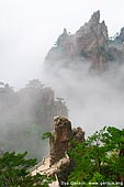 landscapes stock photography | Low Clouds in Xihai (West Sea) Canyon, Huangshan (Yellow Mountains), Anhui Province, China, Image ID CHINA-HUANGSHAN-0012. Surrounded by the hills in the Xihai Area, the Xihai Grand Canyon (West Sea Grand Canyon) is the best place to view the bizarre rock formations of Huangshan Mountain. A hiking tour into this canyon follows stone steps, mountain roads, tunnels, and bridges. As the most beautiful and deepest part of Huangshan Scenic Spot, the Xihai Grand Canyon has never failed to inspire visitors.