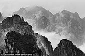 landscapes stock photography | Huangshan Mountains, Cloud-dispelling Pavilion, Xihai (West Sea) Grand Canyon, Baiyun Scenic Area, Huangshan (Yellow Mountains), China. Huang Shan (Yellow Mountain), located in eastern China's Anhui Province, is famous for its countless jagged rock towers, beautifully wind-sculpted pine trees, and seas of swirling clouds. It resembles a sumi painting more than a real place. It is a subject of traditional Chinese paintings, literature and modern photography. It is UNESCO World Heritage Site, and one of China's major tourist destinations.