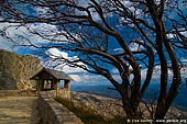 landscapes stock photography | Old Stone Hut and View over Australian Alps from The Horn, Mount Buffalo National Park, Victoria, Australia, Image ID MOUNT-BUFFALO-VIC-0007. Stock photo of the old rock built hut nicely surrounded by a curved dry tree at the starting point of the Horn mountain summit walking in Mount Buffalo National Park, Victoria Hight Country, Australia.