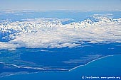 landscapes stock photography | Aerial View of the Aoraki/Mount Cook and Southern Alps, South Island, New Zealand, Image ID NZ-AORAKI-MOUNT-COOK-0005. Stock photo of aerial view of the West coast of New Zealand and the Aoraki/Mount Cook and Southern Alps, South Island, New Zealand as seen from an airplane.