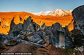 landscapes stock photography | Castle Hill, Canterbury Region, South Island, New Zealand, Image ID NZ-CASTLE-HILL-0005. Limestone boulders on Castle Hill at sunrise with Mount Enys in the background. Castle Hill, Canterbury, New Zealand.