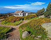 landscapes stock photography | Craig's Hut, Alpine National Park, Mansfield, Victoria, Australia, Image ID AU-MANSFIELD-CRAIGS-HUT-0003. Craig's Hut - one of the most famous High Country huts. Perched atop Mt Stirling, Craig's Hut offers stunning views of the ranges and is one of the regions most photographed landmarks. First built as a set for The Man From Snowy River film in 1981–82, the hut has now become an iconic symbol of Australia's settler history. In 2006 the Craig's Hut was burnt down by bushfires. It was completely rebuilt and reopened to the public in January 2008. It is situated on Mt Stirling, approximately 51 kilometres from Mansfield. The last 1.2 kilometres is only accessible by 4WD or via the walking track from the Day Visitor Area. Access tracks via Mt Stirling are closed to vehicles for Winter.