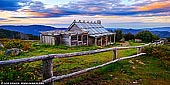 landscapes stock photography | Craig's Hut at Twilight, Alpine National Park, Mansfield, Victoria, Australia, Image ID AU-MANSFIELD-CRAIGS-HUT-0004. Craig's Hut near Mt Stirling, Victoria is considered as one of 100 Best Views In Australia. Drive up towards Mt Buller from Mansfield, then take a left after the Mirimbah tollgate onto Stirling Road. Then it's 8km of sealed road to Telephone Box Junction, the limit for vehicles in winter. But in the warmer months you can continue to the gravel by 2WD Circuit Road: turn left and drive for 20km to the junction with Clear Hills Track. From there it's a 20-minute walk or short 4WD drive to Craig's Hut. The spectacular, minimally developed Mt Stirling attracts cross-country skiers, horse riders and bushwalkers. The original Craig's Hut, inspired by those used by cattle drovers for temporary shelter, was built for the movie The Man from Snowy River (1982) but burnt down in a bushfire. This replica - with a tin rather than bark roof - was completed in 2008.