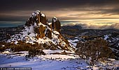 landscapes stock photography | The Cathedral on a Stormy Morning, Mount Buffalo National Park, Victoria, Australia, Image ID AU-MOUNT-BUFFALO-0002. Described by geologist Edward John Dunn as the 'Garden of the Gods', Buffalo Plateau offers numerous photo opportunities for the avid photographer/bushwalker. Imposing granite peaks and vistas encompassing the entire Australian Alpine region make this a worthwhile place to spend a few days. This photo was made on a winter morning right before snow storm hit Mount Buffalo National Park.