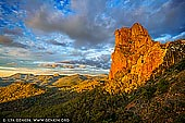 landscapes stock photography | Belougery Spire at Sunset, Warrumbungle National Park, New South Wales (NSW), Australia, Image ID AU-WARRUMBUNGLES-0002. This iconic Warrumbungle National Park walk is famous for its wildlife and vistas of rugged volcanic landscape. Breadknife and Grand High Tops walk is the jewel in the glistening crown and is must do for bush walkers who love a challenge with their scenery. The track follows Spirey Creek before climbing steeply to give close encounters with iconic formations such as Belougery Spire, Bress Peak and Crater Bluff.