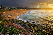 landscapes stock photography | Stormy Sunrise at Bondi Beach, Sydney, NSW, Australia, Image ID AU-BONDI-BEACH-0003. Threatening storm clouds loom above Bondi Beach in Sydney, NSW, Australia during a very vivid sunrise. While most people take cover at the first sign of a storm or the gathering of menacing clouds, a scene like this is almost too good to leave without a photo.