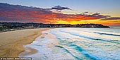 landscapes stock photography | Amazing Sunrise Above Bondi Beach, Sydney, NSW, Australia, Image ID AU-BONDI-BEACH-0001. Fascinating cloud formations of extraordinary hues fill the sky at sunrise over Bondi Beach in Sydney, NSW, Australia. A dramatic sunrise is captured while clouds hang low over the Bondi Beach. This breathtaking scenery is just one of the elements that attracts visitors to this area of Sydney and Eastern Beaches.