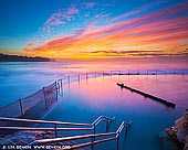landscapes stock photography | Beautiful Sunrise at Bronte Baths, Bronte Beach, Sydney, NSW, Australia. Bronte Beach is one of the best places in Sydney to watch a sunrise. While it's cold here in winter, Sydney tends to get the most intense colour sunrises and sunsets in late autumn, winter and early spring so it's often worth braving the cold and go shooting. Take a cup of hot coffee with you - you will need it for a winter sunrise.