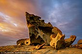 landscapes stock photography   Dramatic Sunrise at The Remarkable Rocks, Flinders Chase National Park, Kangaroo Island, SA, Australia, Image ID KI-REMARKABLE-ROCKS-0003. Nature has carved the well-named Remarkable Rocks in the Flinders Chase National Park on Kangaroo Island, SA, Australia. On top of a huge dome-shaped granite mound are many weirdly shaped granite boulders. Their cavernous shell like appearance is a result of rock being dissolved. Water collecting in cracks and on surfaces, is protected from sunlight and wind, and gradually weathers the rocks. The microscopic roots of the orange coloured lichen further contribute to this weathering. This is an Australian geographical oddity, attracting visitors from all over the world.