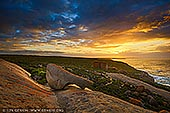 landscapes stock photography | Dramatic Sunrise at The Remarkable Rocks, Flinders Chase National Park, Kangaroo Island, SA, Australia, Image ID KI-REMARKABLE-ROCKS-0004. The Remarkable Rocks in Flinders Chase National Park on Kangaroo Island, Australia is one of the best spots in Australia to watch sunrise. This natural formation of granite boulders, perched on a large rock provides a great location for a sunrise photograph. Too early for tourists, it's an opportunity to begin the day in peaceful solitude as the light of the rising sun hits the boulders.