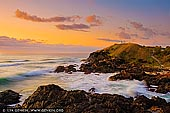 landscapes stock photography | Tacking Point Lighthouse at Sunrise, Port Macquarie, Mid North Coast, NSW, Australia, Image ID AU-PORT-MACQUARIE-0001. Tacking Point Lighthouse is Australia's third oldest lighthouse. It was built on a rocky headland about 8 kilometres south of Port Macquarie in 1879 by Shepherd and Mortley, to a design by the New South Wales Colonial Architect, James Barnet. The lighthouse was one of a series of five small navigational lighthouses of this design. The Keeper was withdrawn in 1919 when the light was replaced by automatic flashing lights. The foundations of the Lighthouse Keeper's Cottage can be seen next to the lighthouse. This building has been classified by the National Trust.