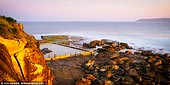 landscapes stock photography | Sunset at North Curl Curl Rockpool, Sydney, NSW, Australia, Image ID AU-CURL-CURL-0001. Beautiful 2:1 panoramic image of the rock pool at the end of the headland at North Curl Curl Beach in Sydney, NSW, Australia. During high tide it can only be accessed via the coastal walk across the headland.
