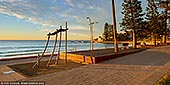 landscapes stock photography | Dee Why Beach Corso at Sunrise, Dee Why, Sydney, NSW, Australia, Image ID AU-DEE-WHY-BEACH-0002. Dee Why Beach Corso has been stylishly designed with a mix of stainless steel street furniture, picnic tables, elegant looking lamp posts and shower units. Breakfast at Dee Why Beach, at one of the cafes on the beachside strip, is a great way to start the day. A promenade, grass picnic stretch and road separates the cafes from the soft sands but does not detract from the views of the glistening seas. Most cafes offer both alfresco and inside dining.