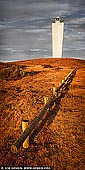 landscapes stock photography | Cape Jervis Lighthouse, Fleurieu Peninsula, South Australia (SA), Australia, Image ID AU-CAPE-JERVIS-LIGHTHOUSE-0002. Vertical panoramic image of the Cape Jervis Lighthouse in South Australia on a late afternoon. Too often people are travelling to or from Kangaroo Island just passing this beautiful lighthouse without stopping, relaxing and watching beautiful sunsets. Vibrant hues created by the sunset is a vision of beauty.