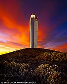 landscapes stock photography | Late Sunset at Cape Jervis Lighthouse, Fleurieu Peninsula, South Australia (SA), Australia, Image ID AU-CAPE-JERVIS-LIGHTHOUSE-0003. Cape Jervis Lighthouse with dramatic red, orange and yellow clouds above catching last rays of the setting sun. The lighthouse marks the northern entrance to the Backstairs Passage between the mainland and Kangaroo Island. Located on the cape at Lands End, the tip of the Fleurieu Peninsula, about 1.5 km (1 mi) south of the town of Cape Jervis and 400 m (1/4 mi) north of the Kangaroo Island ferry terminal. Cape Jervis is the jumping off point for daily car and passenger ferry services to Kangaroo Island. It's a 45 minute journey that reveals the spectacular coastline of this part of the Fleurieu Peninsula. Cape Jervis is a popular base for fishermen, with good boat, jetty and beach fishing. Cape Jervis is on Tourist Route 52 and part of the Fleurieu Way Tourist Drive.