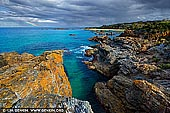 landscapes stock photography | Mystery Bay Coast after Storm, Mystery Bay, Eurobodalla, South Coast, NSW, Australia. A dramatic nature coastline of rugged rocks near Mystery Bay on the far south coast of NSW, Australia right after the storm. Mystery Bay is a small town and a beautiful rocky bay located 15 kilometres south of Narooma. Is it a popular camping spot and it fronts the ocean and is one of the few natural camping areas remaining on NSW south coast. The elevated rocks offer fabulous scenic views out to the Pacific Ocean where you are likely to see whales during their spring migration.