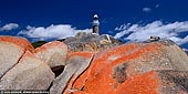 landscapes stock photography   Eddystone Point Lighthouse, Mount William National Park, Tasmania (TAS), Australia, Image ID TAS-EDDYSTONE-POINT-LIGHTHOUSE-0001. Panoramic photo of the Eddystone Point Lighthouse with lichen covered rocks in foreground. Tasmania's Eddystone Point Lighthouse resides almost as far North-East of the island in the Mount William National Park at the northern end of the Bay of Fires, known for its red lichen covered rocks which contrast against the deep blues of the sky or the Tasman Sea.