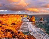 landscapes stock photography | Vivid Sunset at The Twelve Apostles, Great Ocean Road, Port Campbell National Park, Victoria, Australia, Image ID APOST-0035. The viewing platform at the world-famous Twelve Apostles site offers exceptional views out across this ancient rock formation, where the jutting shapes carve interesting silhouettes against the setting sun. At just a five-minute walk from the car park, the viewing platform is the ideal place to catch sunrise or sunset. While the location is open all year round, the best time to shoot here is in the late spring through to the early autumn when the weather is warm. The Apostles are best viewed at sunrise and sunset. However, on a day with a lot of cloud activity, you can probably pull off some good shots through till the late morning.