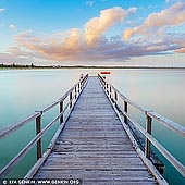 landscapes stock photography | Ellen Cove Jetty at Sunset, Middleton Beach, Albany, Western Australia (WA), Australia, Image ID AU-WA-ALBANY-ELLEN-COVE-JETTY-0001. Ellen Cove Jetty also known as Middleton Beach Jetty is a jetty found at the southern end of Middleton Beach in King George Sound in Albany in the Great Southern region of Western Australia. The Jetty was originally built in 1900 as an alternative to off-load supplies and stock, as some larger ships could not navigate the entrance to Princess Royal Harbour and use the main port. Once port facilities improved the jetty was no longer used for this purpose. It is now primarily used for recreational purposes. It is a popular swimming and fishing spot, and an iconic part of Ellen Cove featured in many photographs of the area.